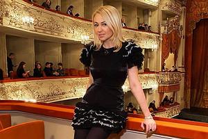 Яну Рудковскую раскритиковали за наряд с красными ботфортами (и вновь поздравили с беременностью)