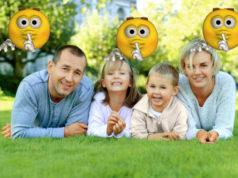 Family lying on the grass and smiling